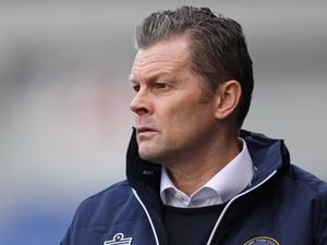 Steve Cotterill the head coach / manager of Shrewsbury Town gestures.