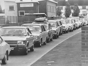 nostalgia pic. Ketley. A traffic jam in Ketley in July 1975. This is a print in the Shropshire Star picture archive and the caption pasted on the back reads: 'Nose to tail mayhem for holidaymakers on the A5 at Ketley today.' The date written on the caption is 26/7/75 i.e. July 26, 1975, which will indicate the publication date, and also as the caption says 'today' the day it was taken. It was a Saturday. The location is Holyhead Road, Ketley. The print has the Shropshire Star copyright stamp and the photographer was Bill Bishton. Ketley roads. Holiday traffic. In the background is Ketley recreation centre. Library code: Ketley nostalgia 2020..