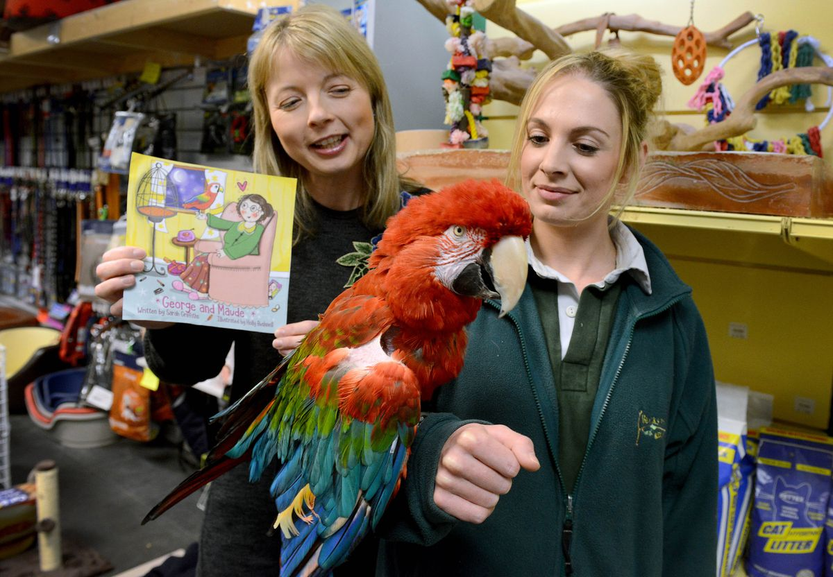 Sarah Griffiths a Shropshire childrens author who has wrote a book about an old lady and a parrot, popped in to Becks Pets & Exotics in Shrewsbury where the worlds oldest greenwing macaw lives