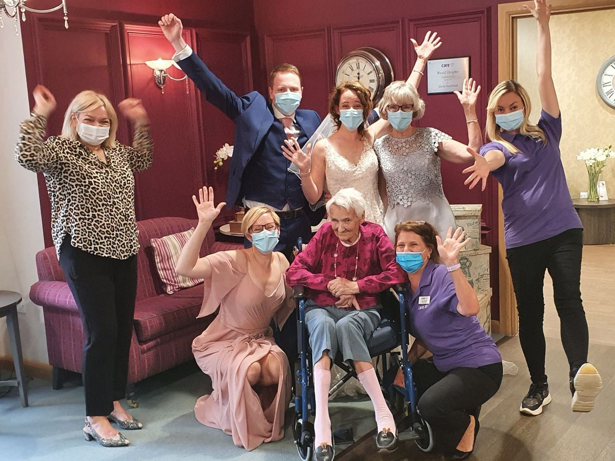 Audrey Dear with her family and care home staff