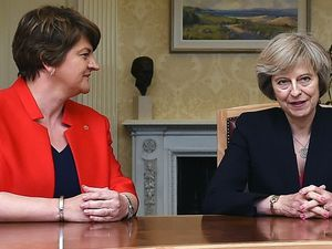Theresa May and Arlene Foster are holding discussions as they look to strike a deal to prop up a minority Conservative government (Charles McQuillan/PA)