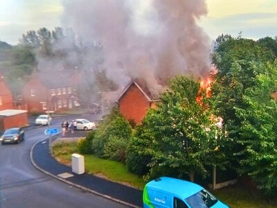 Hero neighbour searches blazing Telford house - with video and pictures
