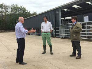 Minister Ranil Jayawardena, centre, and Montgomery MP Craig Williams at Greg Pickstock's farm in Llanfechain