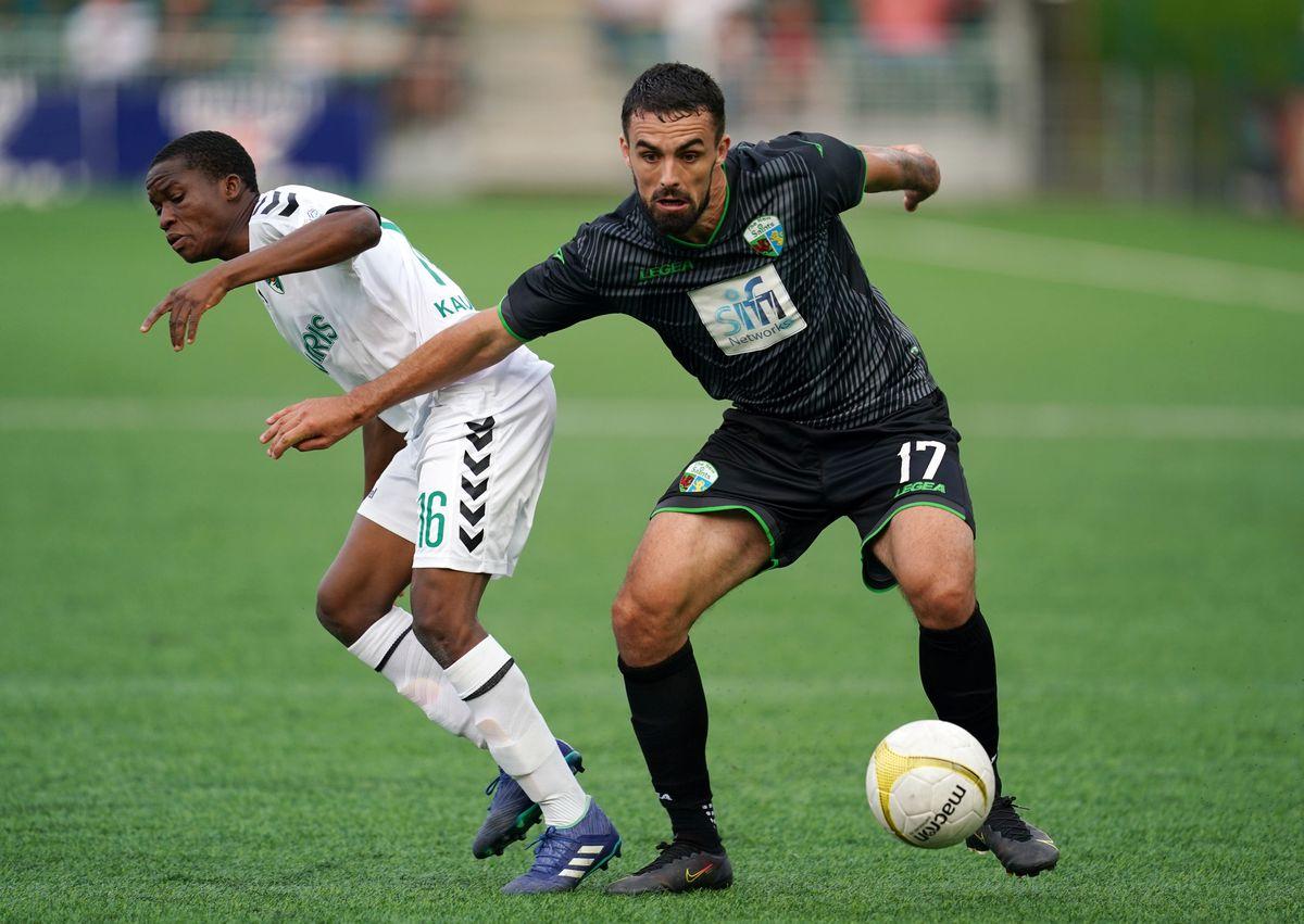 The New Saints' Jordan Williams and Kauno Zalgiris' Abdulgafar Opeyemi battle for the ball at Park Hall, Oswestry