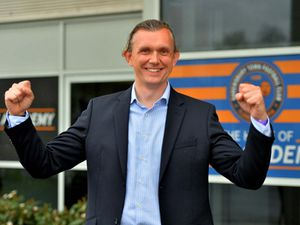 Liberal Democrat Rob Wilson celebrates after defeating council leader Peter Nutting