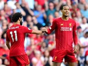 Mohamed Salah (left) celebrates scoring his side's second goal of the game with team-mate Virgil van Dijk