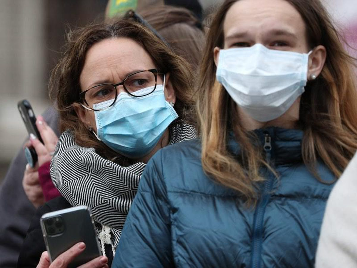 Spectators wearing masks to protect against coronavirus outside the Commonwealth Service at Westminster Abbey