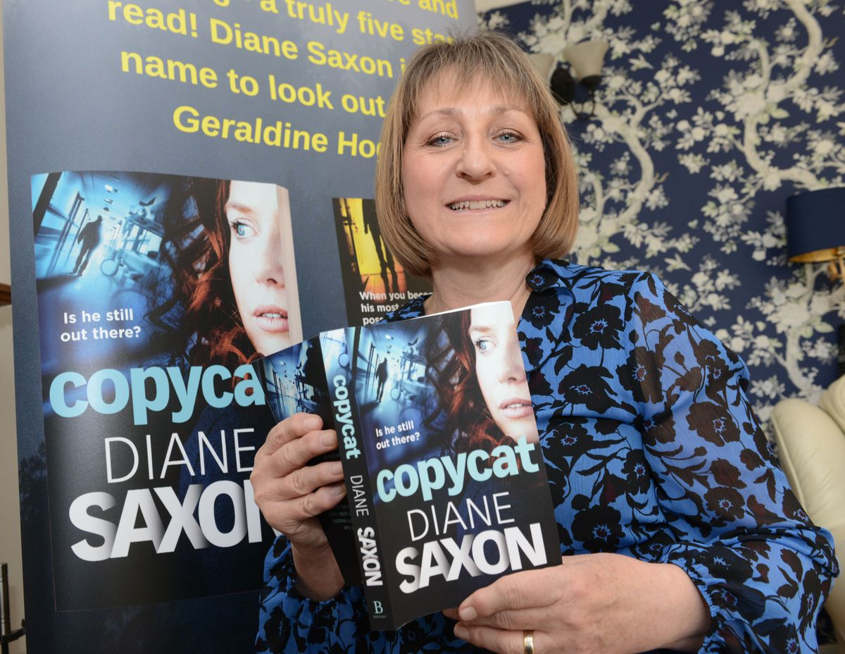 Diane Saxon with her new book