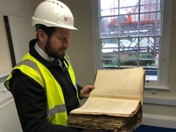 100-year-old documents discovered in forgotten safe during bank restoration