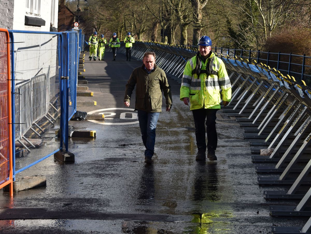 Environment Secretary George Eustice is accompanied by a member of the Environment Agency during a visit to the Wharfage in Ironbridge