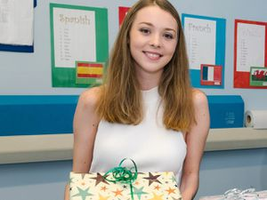 Lottie O'Byrne with some of the care packages she gifts to spinal fusion patients