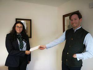 Ellie Stuart receives her £100 prize from Alexander Newport