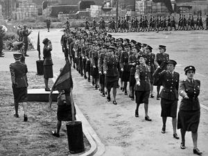 Chief Commander J  T  C  Schwabe taking the salute at the marchpast during the farewell parade of the ATS at Donnington.