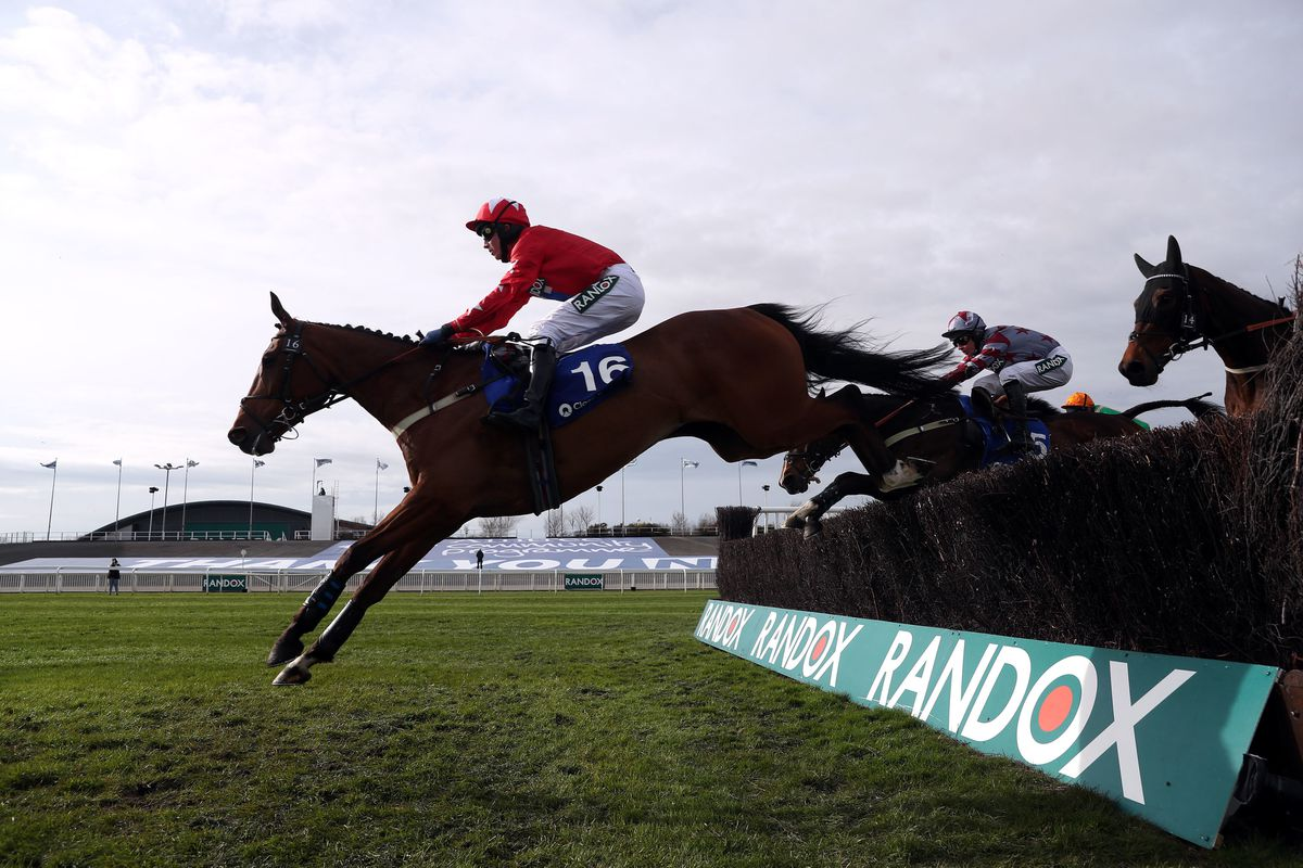 Editeur Du Gite ridden by jockey Joshua Moore clear a fence on their way to winning the Close Brothers Red Rum Handicap Chase during Liverpool NHS Day of the 2021 Randox Health Grand National Festival at Aintree Racecourse, Liverpool. Pic: David Davies/PA Wire for the Jockey Club