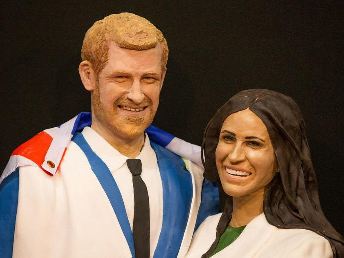 A life-size cake of the Duke and Duchess of Sussex on display during Cake International, The Sugarcraft, Cake Decorating and Baking Show, at the NEC, Birmingham.