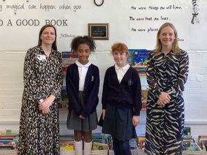 Unveiling a plaque in the newly re-named Liz Brazier Memorial Library at Coleham Primary School are (from left to right) author Lesley Parr, pupils Eva Butelle and Catherine Ryan, and headteacher Claire Jones