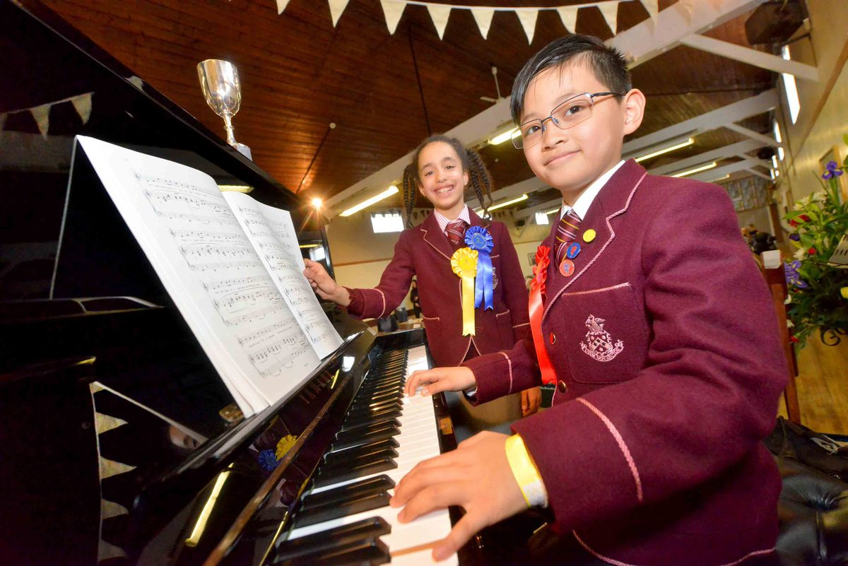 Ellie Lovatt with Min Yen, both nine, at Minsterley Eisteddfod in 2019