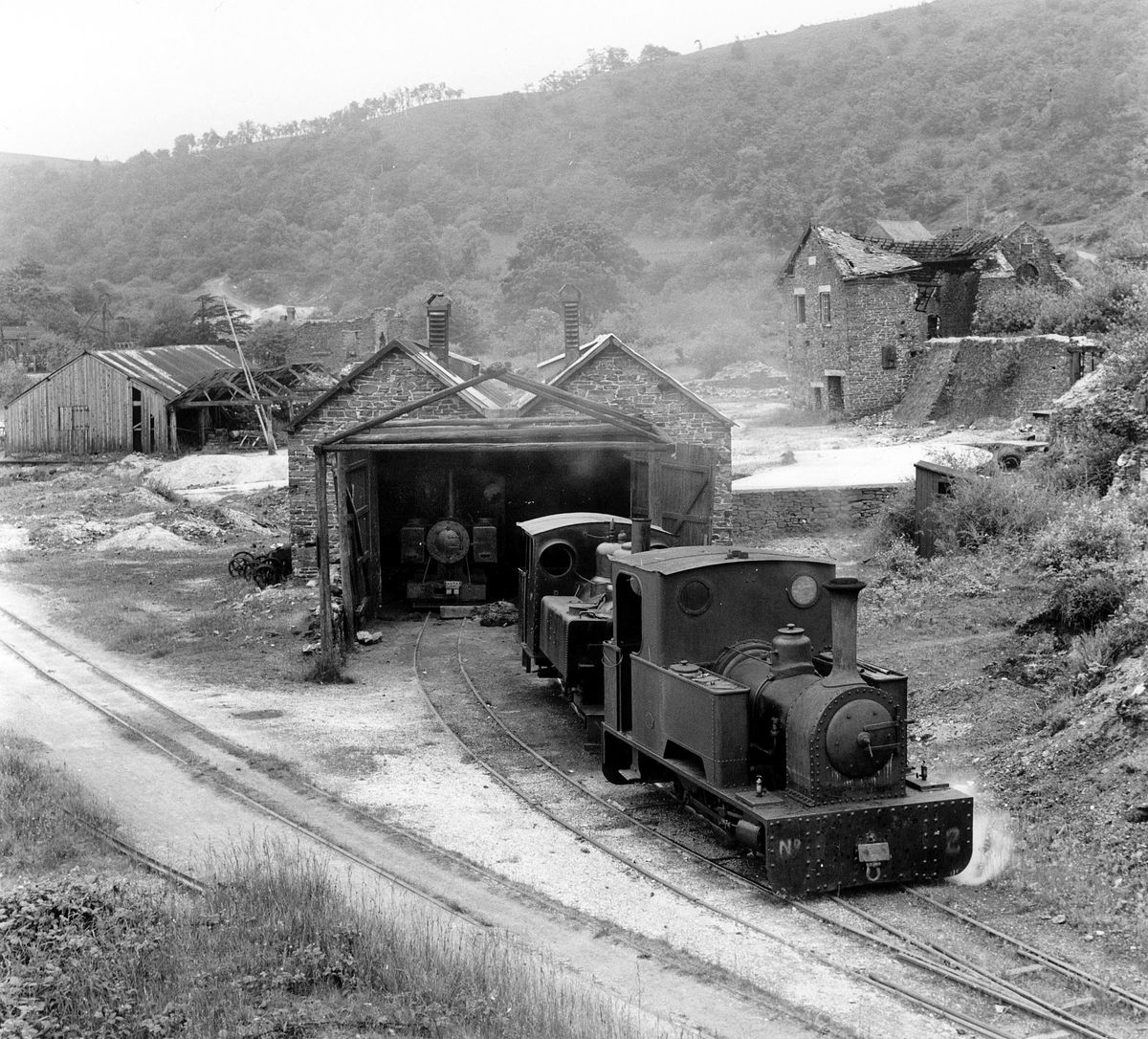 Dickie Preece obligingly hauls each Baldwin locomotive in turn out of the shed for a photo parade on June 11, 1943. In the left background are dressing floor sheds, while to the right is the crusher house.