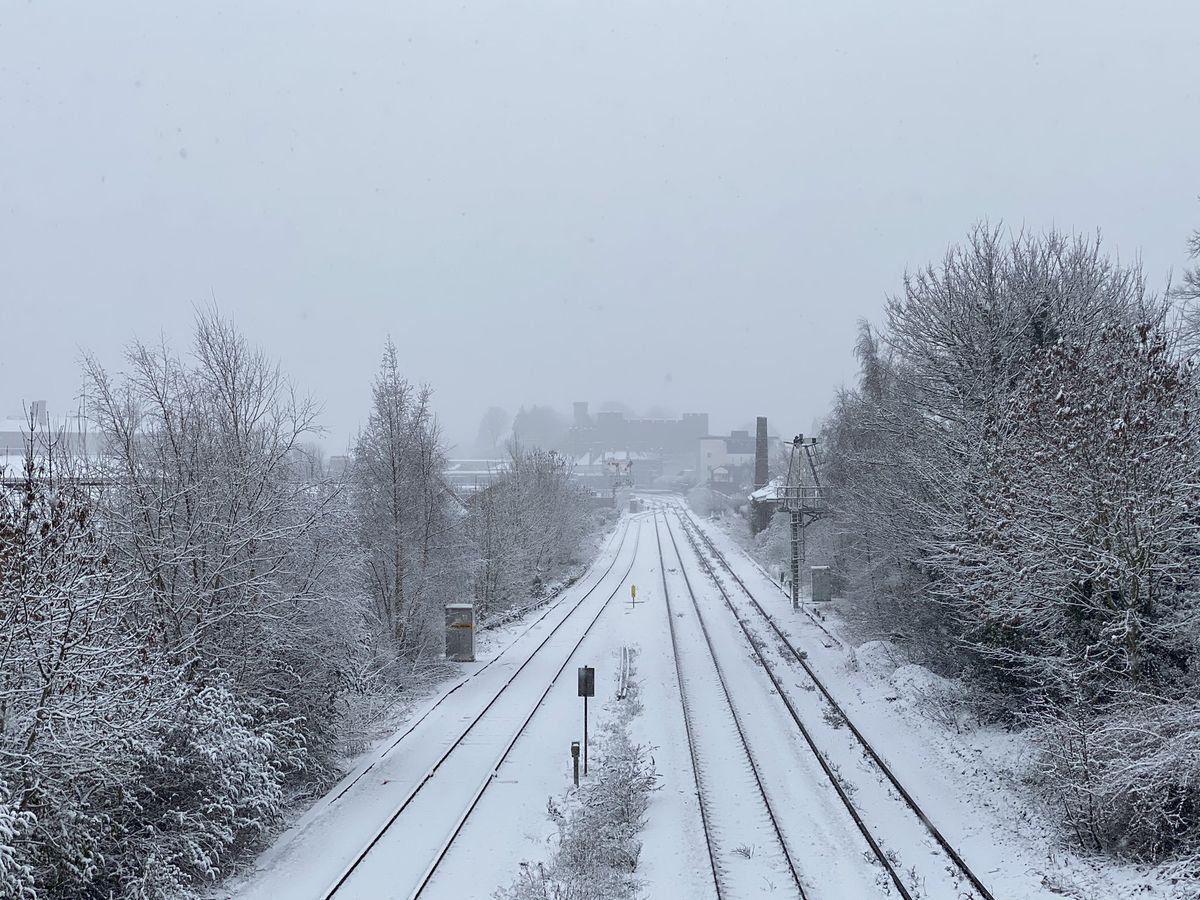 Snow on the train line into Shrewsbury, with the castle in the background. Photo: @maxicheddar