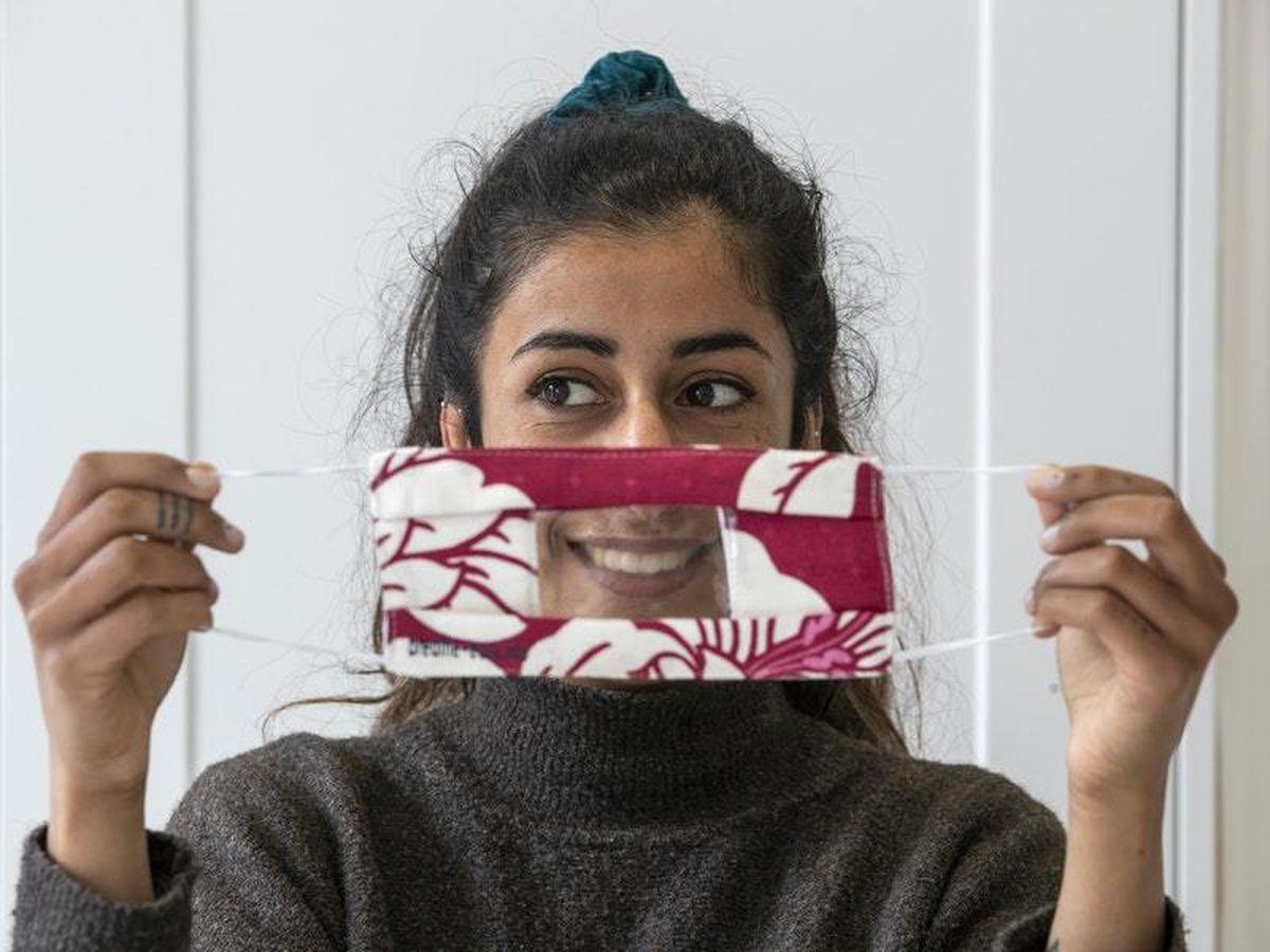 Anjali Punn models a face mask designed for the lip-reading community