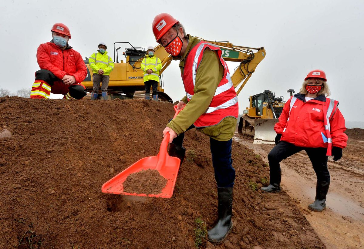 Helping to break the ground at the new base are Midlands Air Ambulance chairman Roger Pemberton, front, with air operations manager Ian Jones and chief executive Hanna Sebright. Behind are Mike Jones and Glyn O'Hara of Morris Property