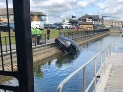 BMW M4 ends up underwater after crashing into marina
