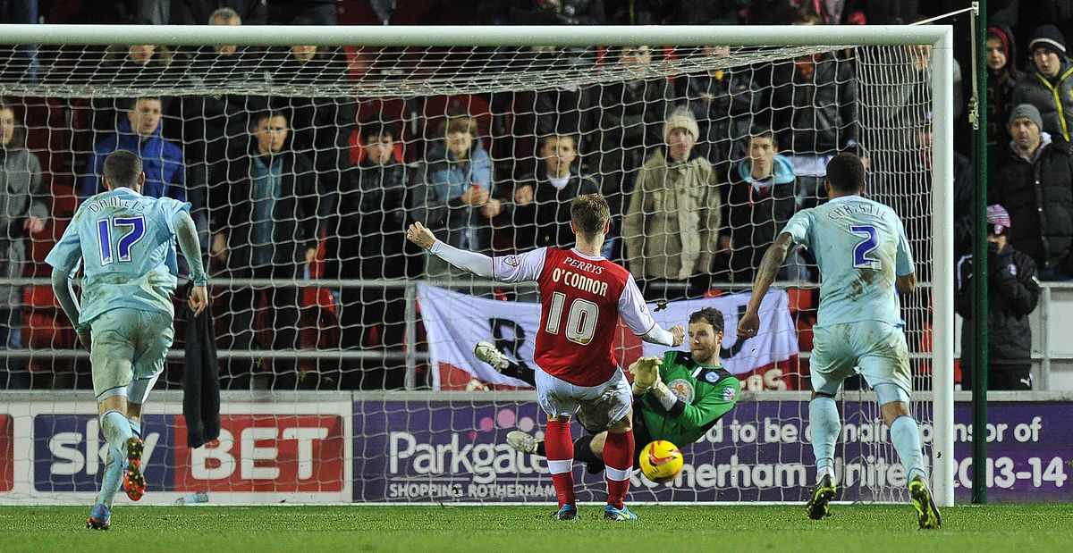 Coventry City's Joe Murphy saves a penalty shot from Rotherham United's Michael O'Connor
