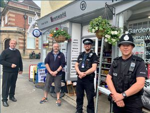 Stuart Wright, of Wrights Estate Agent and John Vine, of Sandford Hardware, with members of West Mercia Police