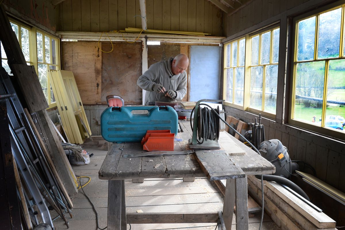 Volunteer Pete Robson at work in the signal box at Corwen station.