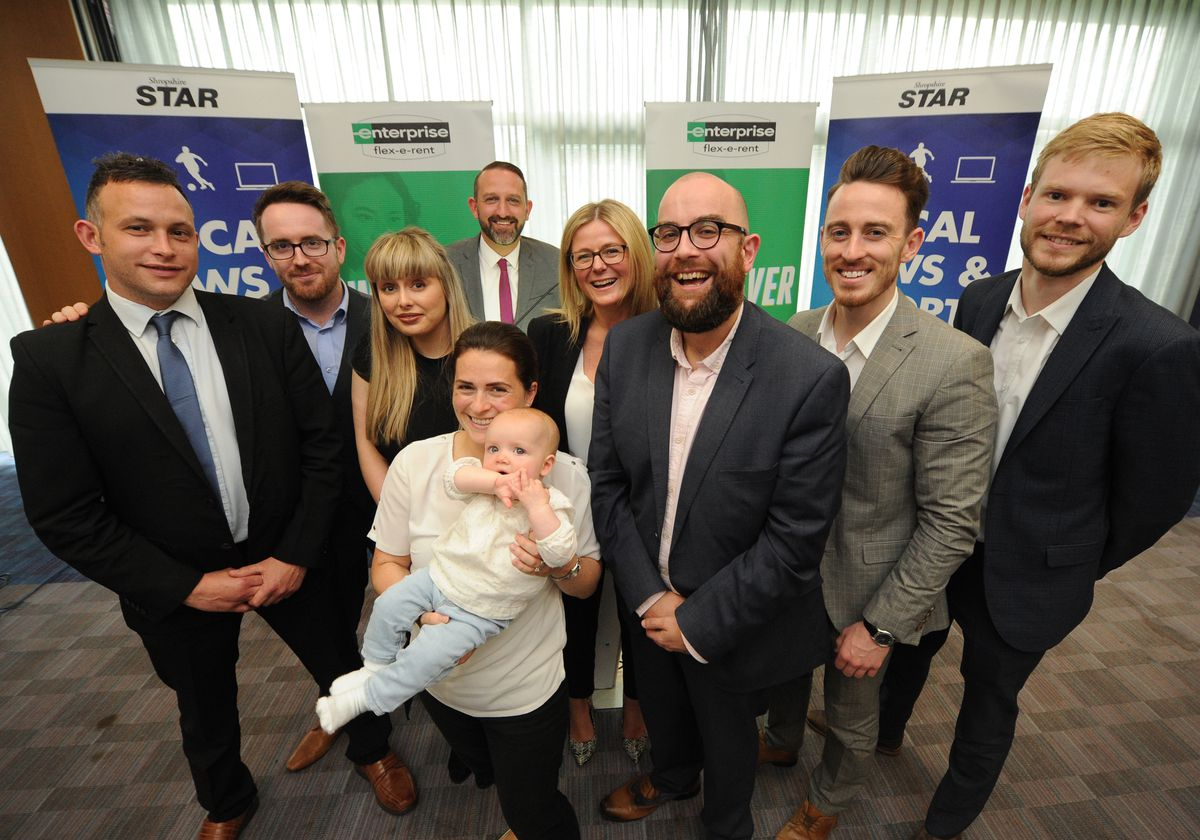 Staff members from Enterprise Flex E Rent attend the Cash For Your Community 2019 presentations, at Shrewsbury Town Football Club