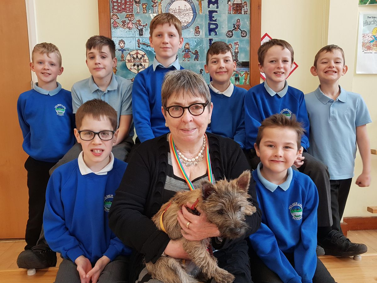 Some of the Holmer Lake Primary School pupils receiving hypnotherapy with Clarissa Woodcock and her dog Millie