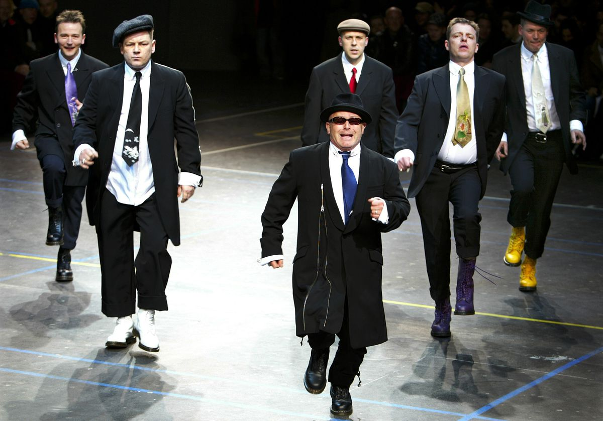 Madness perform a dance as they display creations by Japanese designer Yohji Yamamoto as part of his fall winter 2004/2005 men's collection at Paris fashion week