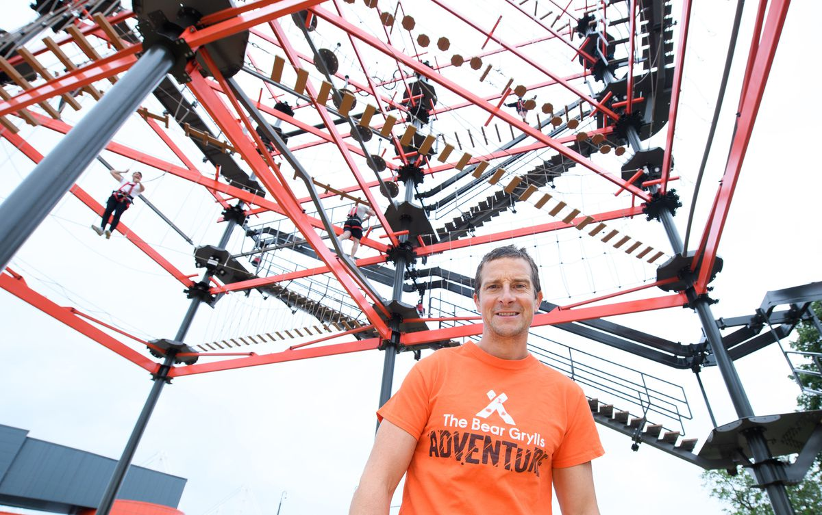 Bear Grylls stands at the foot of the highwire
