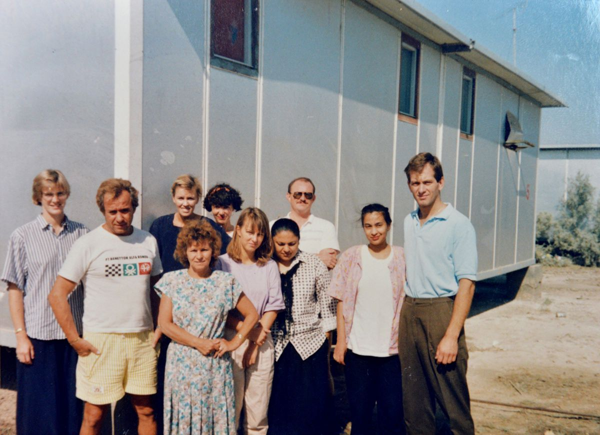 Pictured at the Al-Nasseriya power station in August 1990, Susan, centre in pink, and Simon, far right, in blue shirt
