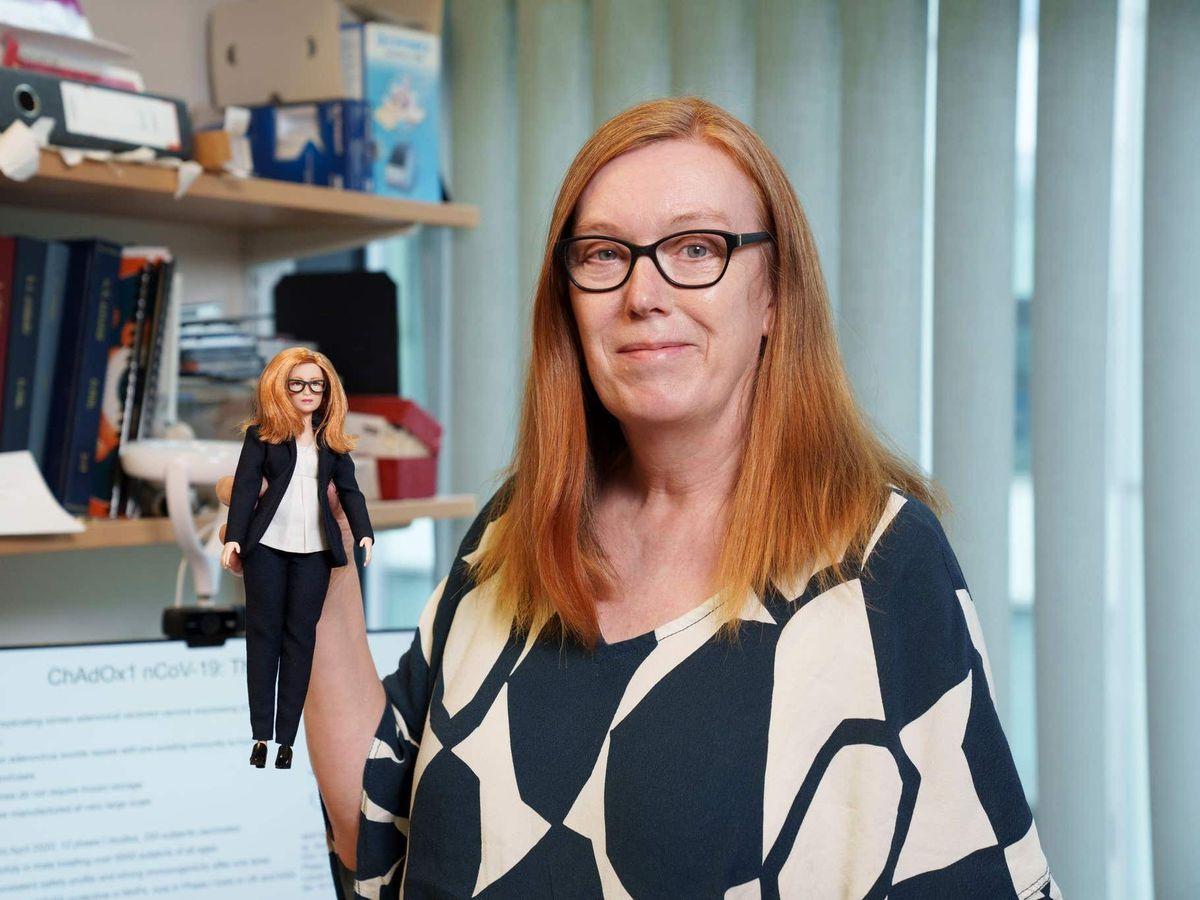 Professor Dame Sarah Gilbert holding her barbie doll