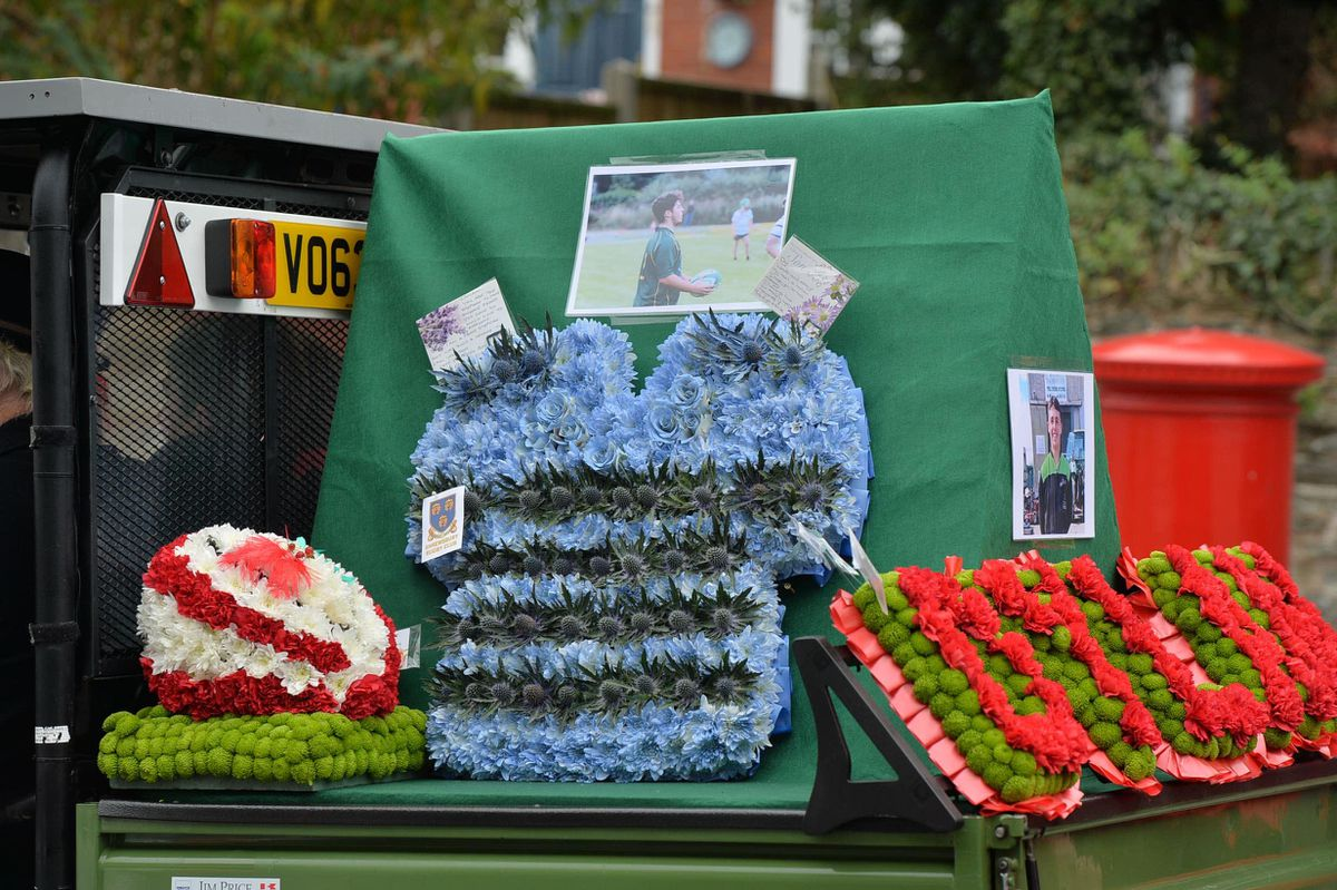 Wreaths included a rugby shirt from Dylan's former club Shrewsbury