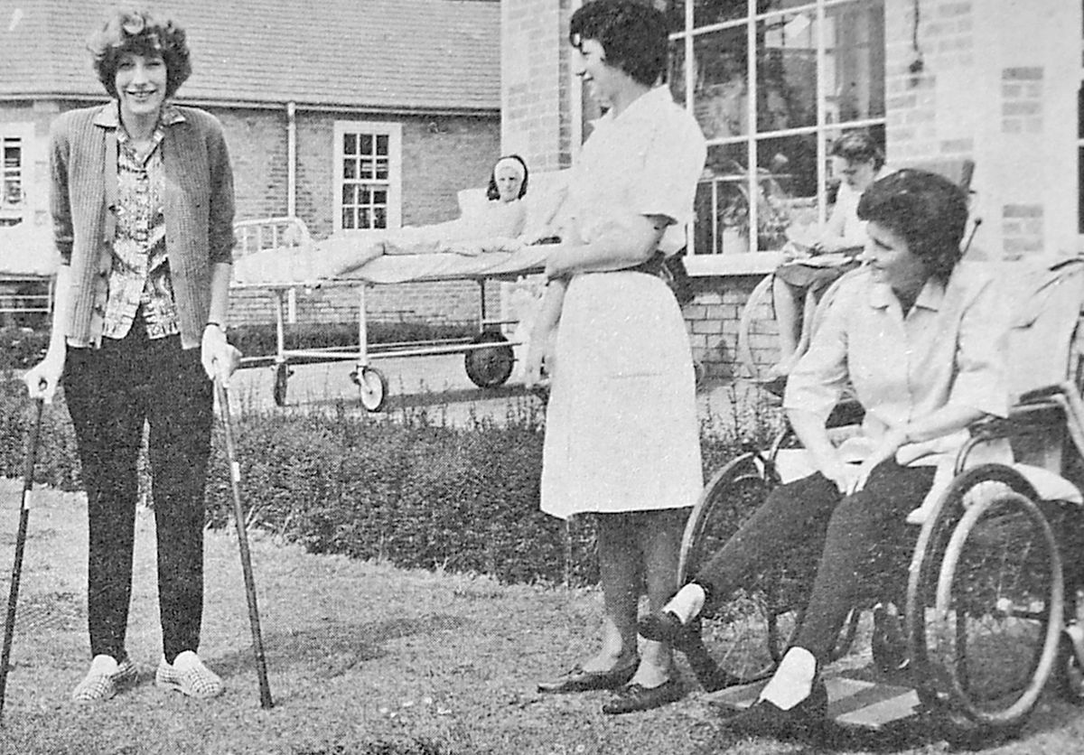 Anne Rowston learning to walk again on sticks at Oswestry's Orthopaedic Hospital after her height-reducing operations.