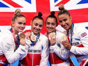Great Britain's Alice Kinsella, Jennifer Gadirova, Jessica Gadirova and Amelie Morgan celebrate with their bronze medals