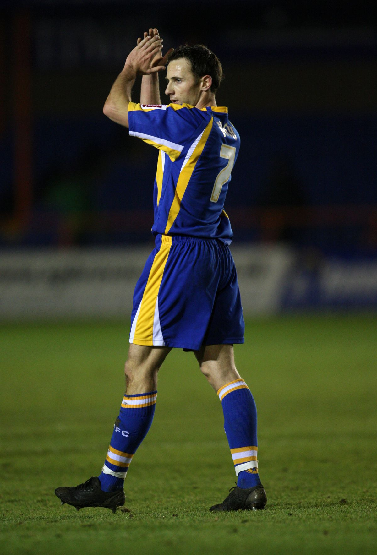 Marc Pugh of Shrewsbury Town applauds the fans after the 0-0 draw