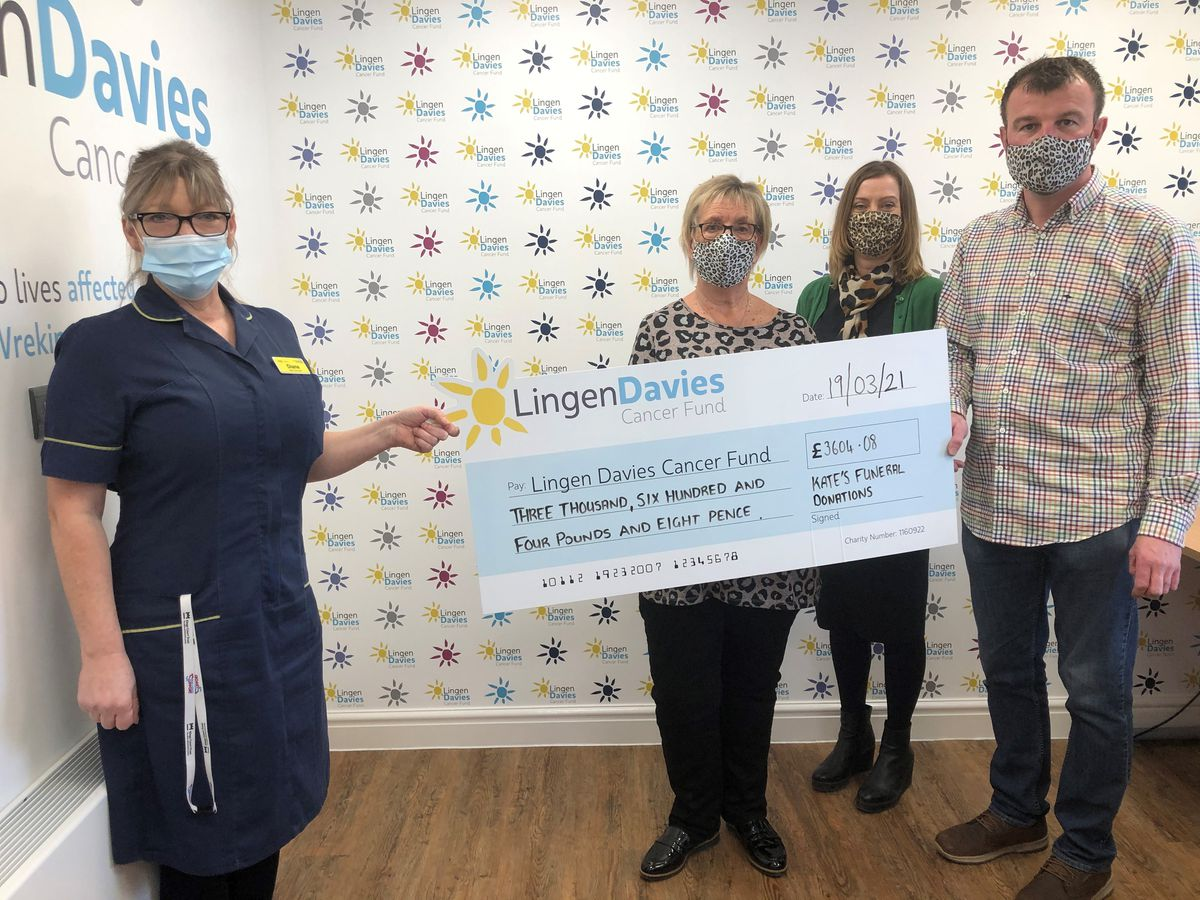 Dean Gill with Kate's Mum Carol Hardy and sister Kelly Griffiths, present the cheque to Di Evanson who helped care for Kate at the Lingen Davies Cancer Centre.