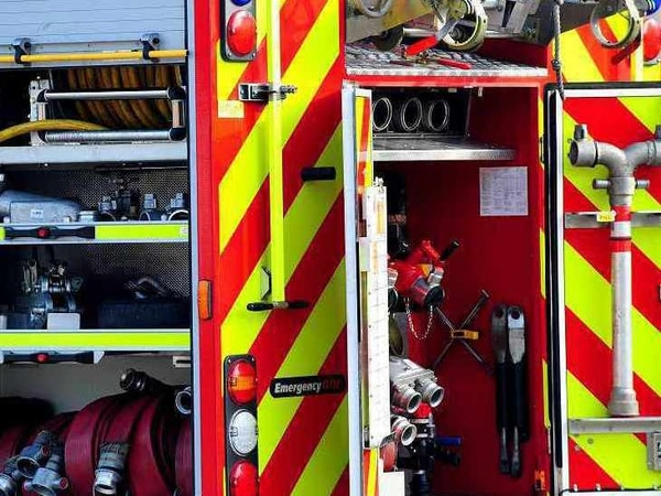 Three people rescued from car in water