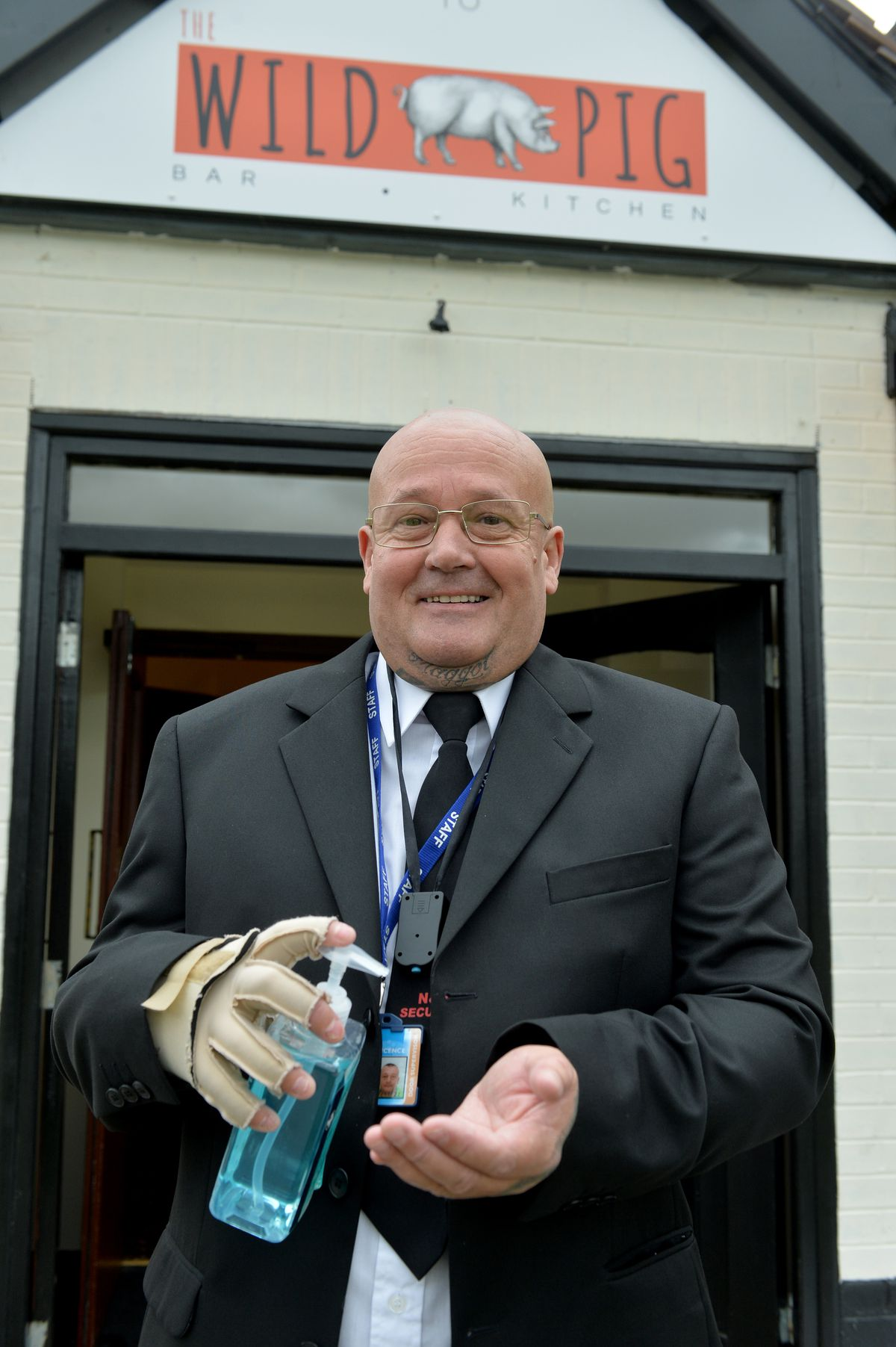 Neil Matthews from N&S Security gets ready to welcome drinkers