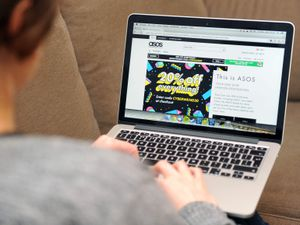 A woman looks at the Asos website