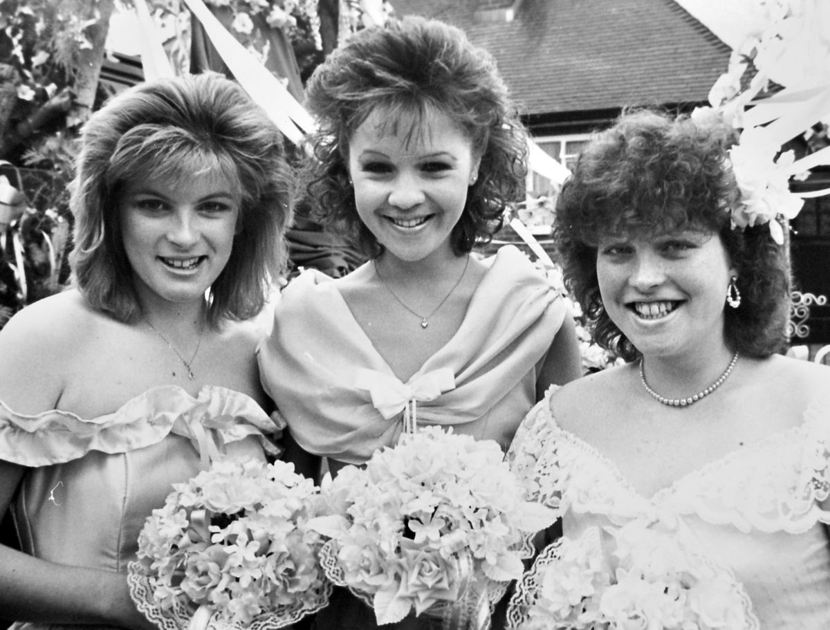 Bridgnorth Festival Queen Claire Fullwood (centre) with attendants Hayley Smith (left) and Helen Dodd preparing to lead the town's carnival procession in 1988.