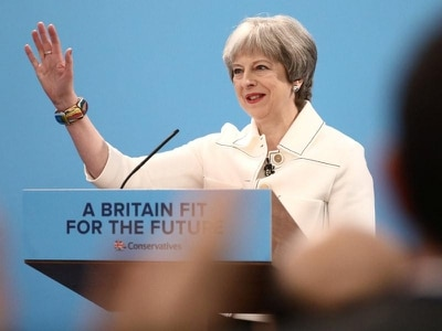 I rely on NHS every day – Theresa May