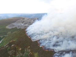Horseshoe Pass fire 'scaled down' after three weeks burning