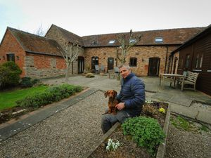 Manager Philip Brick with sprout the dog at Hurst Farm Holiday Cottages