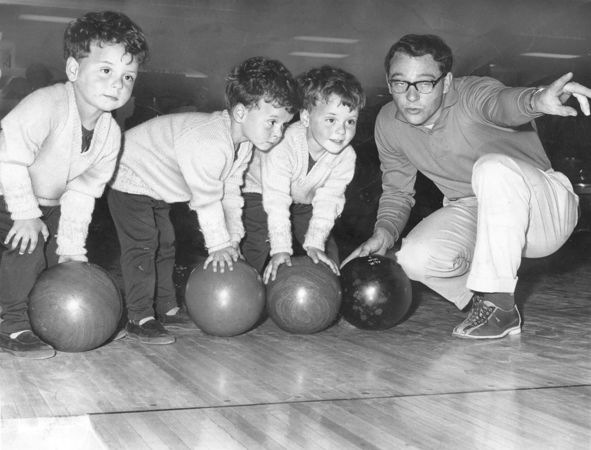 Having a ball at the Ambassador Bowling Centre, Wolverhampton, in July 1965, were the three-year-old Wolverhampton triplets, Paul, Martin, and Andrew Tunney, seen with their dad Graham Tunney, of Tettenhall.  Pub: 3 Jul 1965
