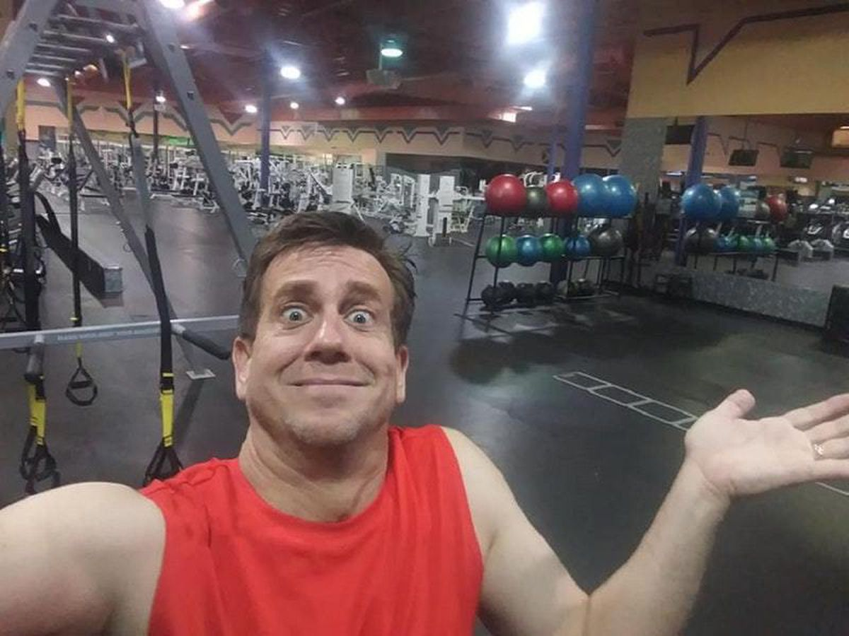 Dan Hill poses in 24 Hour Fitness