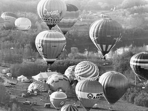 """nostalgia pic. Telford. Hot air balloons taking off in Telford town park in May 1989. This is a print in the Shropshire Star picture archive and the caption pasted on the back reads: 'It was up, up and away in Telford today when around 40 massive hot air balloons reached for the skies. Early morning motorists in the area were greeted by a host of colourful balloons taking part in the balloon fiesta - part of tomorrow's Telford International Day. Picture: Jeff Millward."""" The date on the back is 6/5/89, i.e. May 6, 1989, which will be publication date. Jeff Millward was a Shropshire Star staff photographer so it is Shropshire Star copyright. Library code: Telford nostalgia 2020.."""